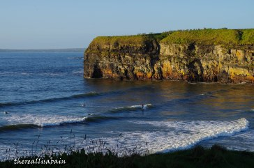 Surfers at Ballybunion Beach.
